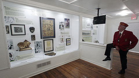 An employee checks out one of the rooms at the new Hank Aaron Childhood Home and Museum.