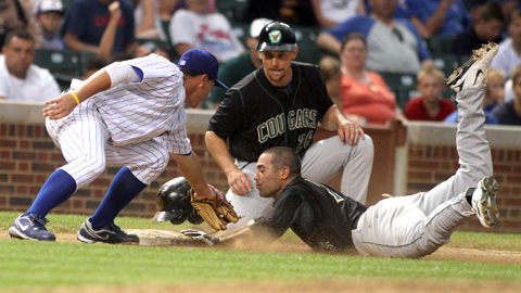 Mike Gilmartin slides into third base as Peoria's Matt Cerda applies the tag.