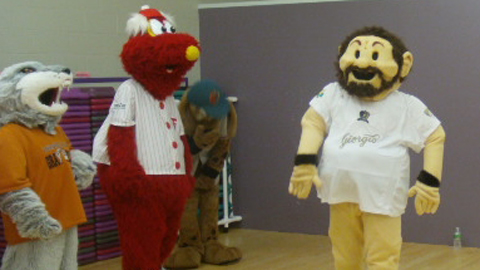 Ben Hill, as Giorgio, practiced his strut as other mascots looked on.