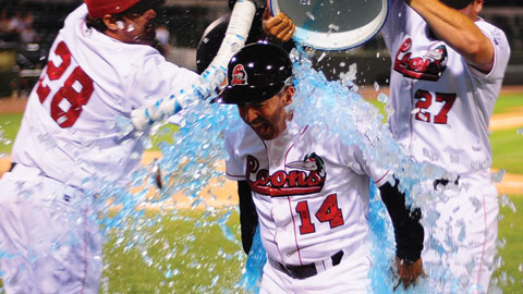 Steve Smith and J.B. Paxson douse Juan Bustabad after the milestone win.