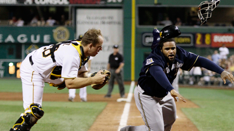 Erik Kratz tagged out Prince Fielder on a tough play at the plate in July.