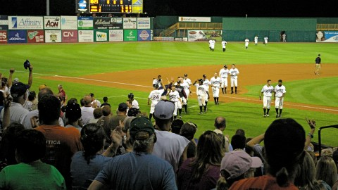 The Timber Rattlers walk off and the crowd celebrates after the Rattlers beat the Cedar Rapids Kernels 6-5 in extra innings on August 14, 2010.