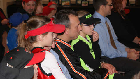 Members of Westland Hills Little League look on during the announcement