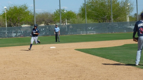 Max Walla rounds second after a home run at the Brewers spring training complex on Saturday, March 26, 2011