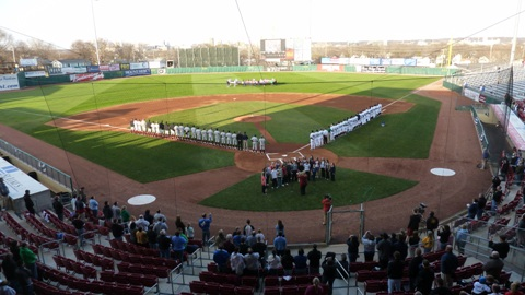 The Rattlers and Kernels line up before Opening Day at Perfect Game Field.