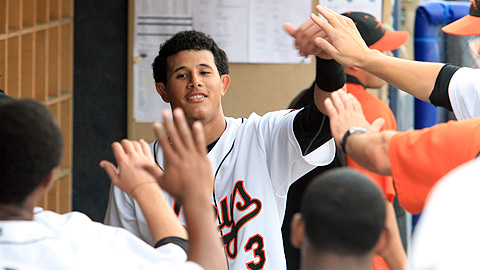 Manny Machado celebrates with teammates after his first Frederick home run.