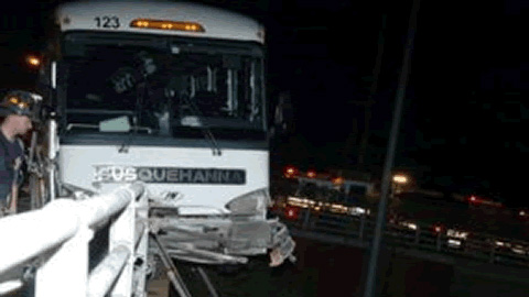 A guardrail prevented the Crosscutters' bus from plunging off a ramp onto the expressway below.