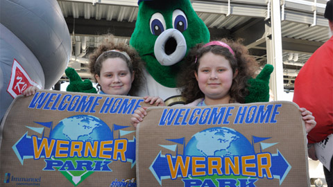 Two young fans roll out the welcome mats on Opening Day.