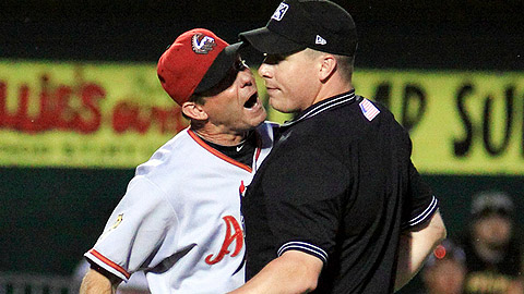 Altoon's P.J. Forbes gets in the face of umpire Andy Dudones on June 24.