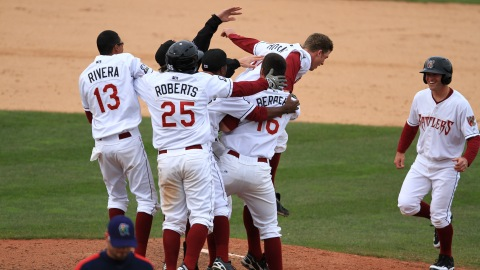 The Wisconsin Timber Rattlers celebrate Parker Berberet's game winning hit on Saturday, April 7, 2012.