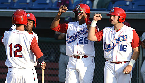 Doubledays teammates congratulate J.R. Higley on his third inning grand slam