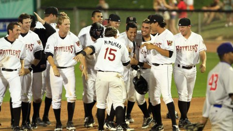 The Rattlers celebrate Rafael Neda's game winning single to beat Peoria on June 29, 2012.