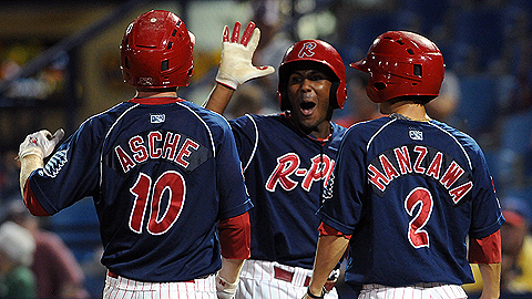 Cody Asche is congratulated by teammates after hitting a three-run HR Sunday.