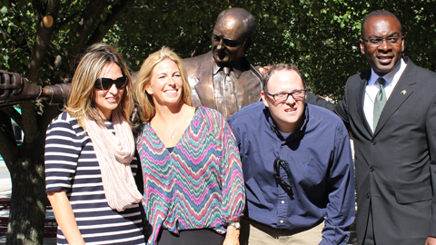 Griffin's kids (from left, Meghan, Maureen, and Tom) pose with their dad's statue, along with Mayor Byron Brown.