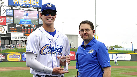 Wil Myers receives his award from Omaha president and general manager Martie Cordaro.