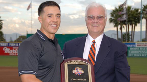 Chris Gonzalez receives his award from California League president Charlie Blaney.