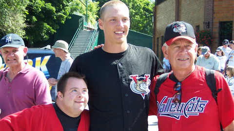 (Hunter Pence poses for a photo with ValleyCats fans in 2004, during a New York-Penn League game at Doubleday Field in Cooperstown, NY.)