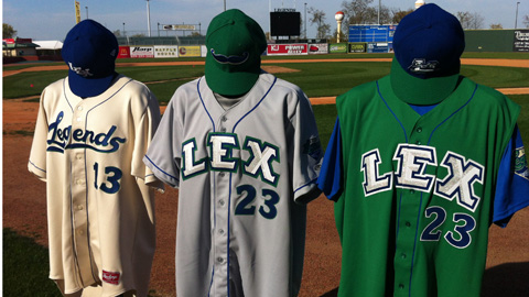 The new road uniforms (center) will feature a mustache-adorned cap.