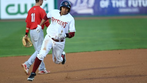Rafael Neda digs for third in a 2012 Timber Rattlers game at Time Warner Cable Field at Fox Cities Stadium.