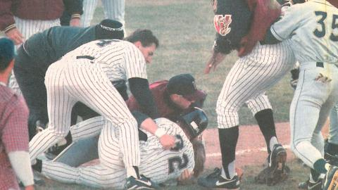 The Wisconsin Timber Rattlers and Beloit Snappers gather to discuss a play in a game on April 24, 1996.